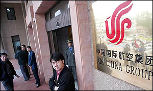 Journalists waiting outside Air China's office in Beijing