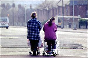 Two women pushing pushchairs   BBC