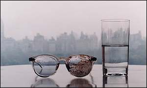 From a limited edition of six, with John Lennon's blood-covered glasses from his assasination, placed on a table with a glass of water, taken in their Dakota  apartment overlooking Central Park