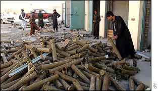 Munitions stockpiled at a garage belonging to ousted Taleban leader Mullah Omar near Kandahar