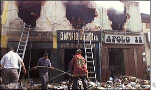 Firefighters tackle looted shops in Caracas