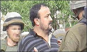 Picture released by the Israeli army showing Marwan Barghouti being arrested by Israeli soldiers