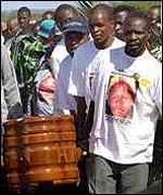 Mourners carry the coffin of Tshepo Matloha, whose death is the subject of a murder trial