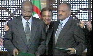 Eritrea and Ethiopian delegates signs the peace agreement in Algiers in 2000