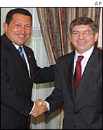 Venezuelan President Hugo Chavez, left, shakes hands with the Secretary-General of the Organisation of American States, Cesar Gaviria