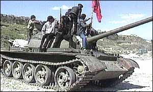 Albanian rebels on top of seized tank in 1997