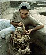 Archaeologist cleans one of the skeletons, PA
