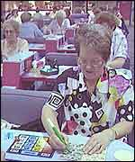 Woman playing bingo at a session.