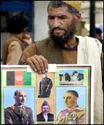 Kabul man holding pictures of Zahir Shah
