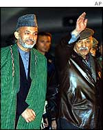 Interim leader Hamid Karzai (left) with Zahir Shah leaving Rome