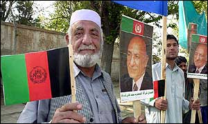 Afghans holding portraits of ex-king in Kabul