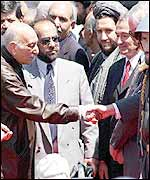 Zahir Shah is greeted by officials at Kabul airport