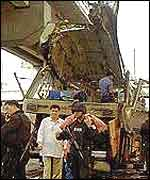 Aftermath of Philippines bus bomb in December 2000
