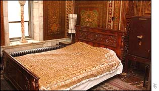 Silk-covered bed in a palace sitting-room