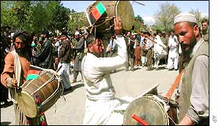 Afghan men celebrate the return.
