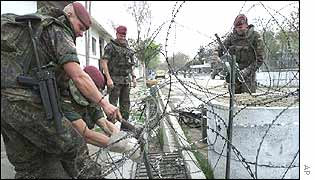 Foreign peacekeepers set up security fences near the villa
