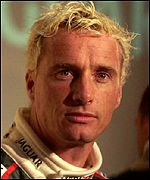 Eddie Irvine drives for Jaguar