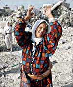 A Palestinian woman wails amid the devastation