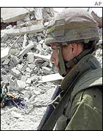 An Israeli soldier amid Jenin rubble
