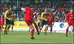 Phil McGuire rattles home Aberdeen's second goal
