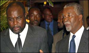 South African President Thabo Mbeki, right, and Congolese Minister for Security Mwenze Kongolo