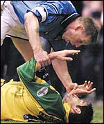 Stuart Pearce stands over Norwich's Steen Nedergaard