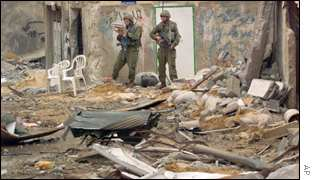 Israeli soldiers surveying the rubble of Jenin