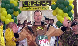 Scott in diving suit at the finish line [photo copyright BBC]