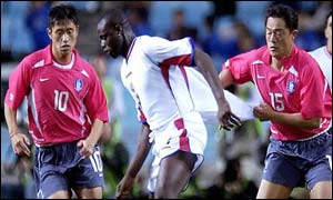 Costa Rica striker Winston Parks is closely policed by Korean defenders