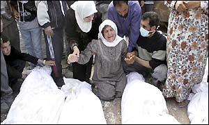 A Palestinian woman mourns over the bodies of Palestinians killed during a week of fierce fighting in Jenin