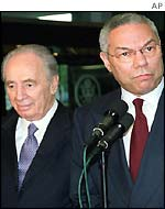 Israeli Foreign Minister Shimon Peres, left, with US Secretary of State Colin Powell