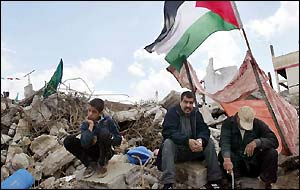 Palestinians perch on what remains of their homes in Jenin