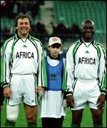 Roger Milla in a charity match with Algerian Rabah Madjer
