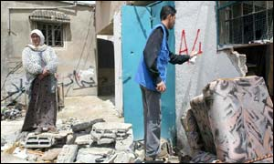 A United Nations' worker marks a home destroyed in the military incursion