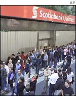 People line up to try and enter the Buenos Aires branch of Scotiabank Quilmes