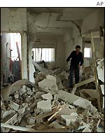 A Palestinian man inspects the damage in the Palestinian Ministry of Public Works in Ramallah