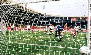 Spurs keeper Erik Thorsvedt watches as Stuart Pearce's free kick whistles past him into the net