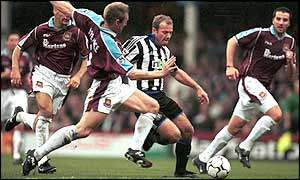 Typically uncompromising Pearce slides in to dispossess his old England and Newcastle teammate Alan Shearer