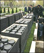 Urns of Nazi child victims await burial