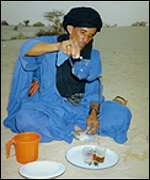 Touareg man making tea in the Sahara