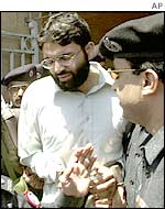 Ahmed Omar Saeed Sheikh being escorted to the court