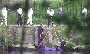 Police divers recover a body from the Thames