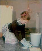 Woman scrubbing the floor