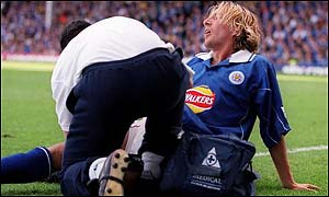 Leicester midfielder Robbie Savage receives treatment