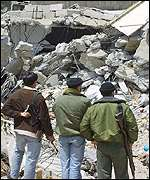 Palestinian men look at the rubble left after the Israeli offensive in Jenin