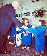 Ariel Sharon greets young immigrants