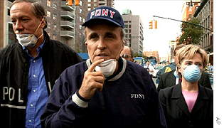 Rudolph Giuliani (centre) tours the site of the World Trade Center on 12 September with New York Governor George Pataki and Senator Hillary Rodham Clinton.