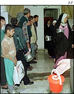 Iraqis queue for food rations