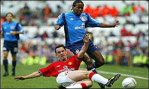 Gary Neville injures his foot in a tackle on Ze Roberto