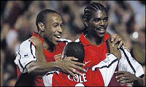 Thierry Henry (left), Ashley Cole and Kanu celebrate Arsenal's second